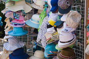 Summer hats from the sun are sold on the market