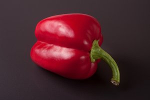sweet red peppers on a dark background