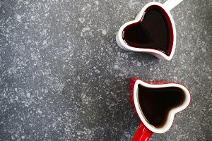 Two heart shaped cups with tea