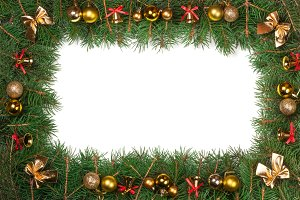 Christmas frame made of fir branches decorated with balls bells and bows isolated on white background