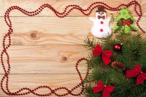 frame decorated Christmas fir branch on a light wooden background