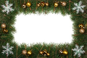 Christmas frame made of fir branches decorated with balls and snowflakes isolated on white background