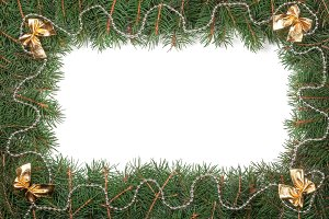 Christmas frame made of fir branches decorated with beads and bows isolated on white background