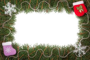 Christmas frame made of fir branches decorated with beads and snowflake isolated on white background