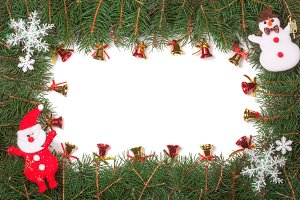 Christmas frame made of fir branches decorated with Santa Claus and bells isolated on white background