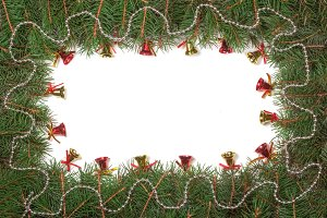 Christmas frame made of fir branches decorated with beads and bells isolated on white background