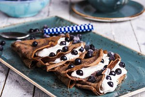 chocolate crepes with cream cheese and blueberries