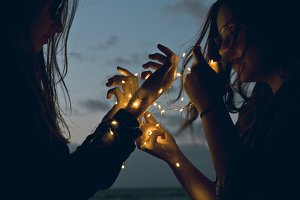 Two girls holding lights