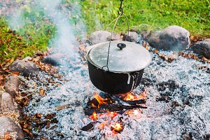 Metal pot over a campfire outdoors