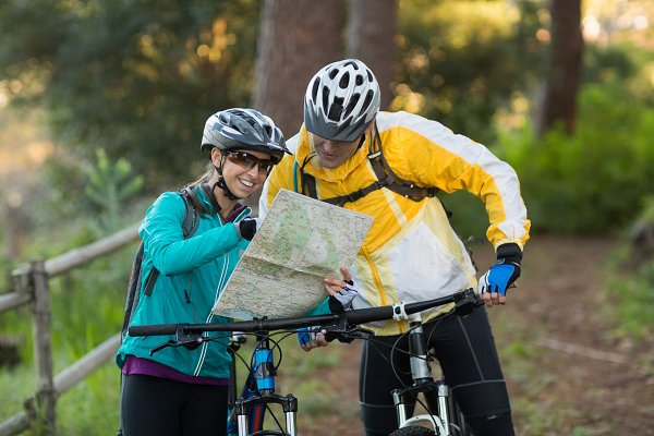 Biker couple interacting over map