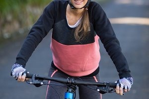 Female biker with mountain bike in countryside