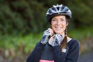 Female biker wearing bicycle helmet
