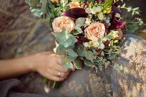 Beautiful original wedding bouquet in the bride hands