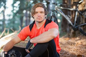 Portrait of male mountain biker in the forest