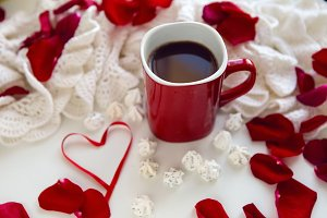 red mug with hot chocolate standing