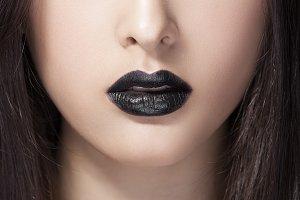 Woman beauty fashion portrait with black lips in studio. Asian coasian model
