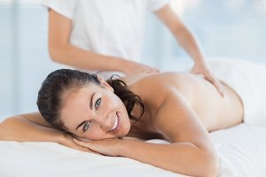 Portrait of smiling woman enjoying massage