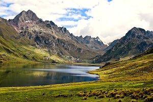 Lake between Mountain Peaks
