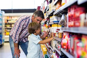 Cute child choosing food from shelf