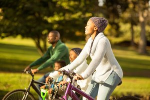 Side view of a young family doing a bike ride