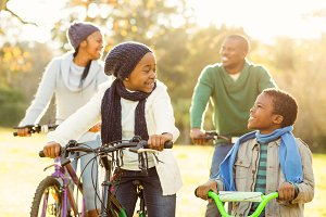 Young smiling family doing a bike ride