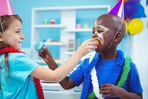 Happy kids enjoying tasty buns