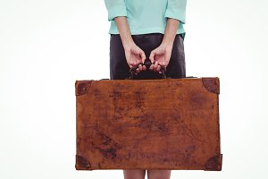 Rear view of hipster woman holding suitcase