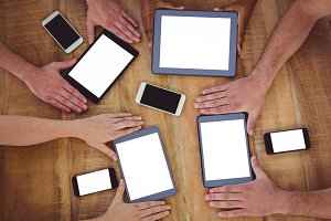 Creative team working together on a tablets and smartphones