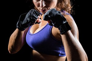 Portrait of woman with fighting stance