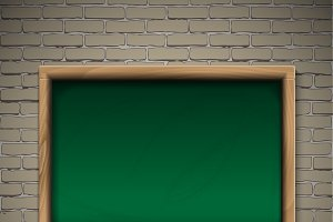 Realistic blackboard on wooden background