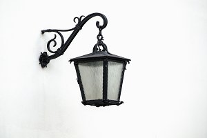 Iron lantern on wall
