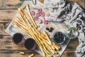 Grissini bread sticks, olives & wine