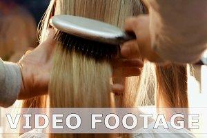 Female model getting her hair dressed