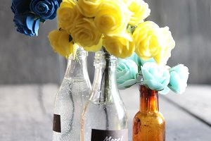 Merci tag, which means Thanks, and nice flowers in the bottles