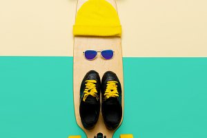 Sneakers, sunglasses, skateboard