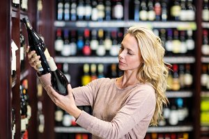 Woman holding bottles of wine