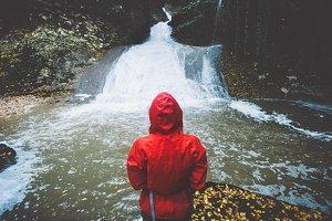 Traveler hiking at waterfall