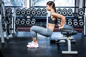 Fit woman doing fitness exercises