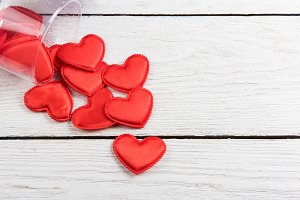 Red hearts on a white wood background
