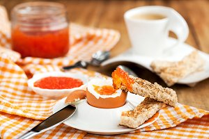 Boiled egg with red caviar
