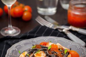 Black pasta with shrimps and caviar