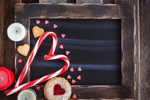 Heart shaped candies on chalk board