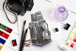 Sketch of camera, camera and paints