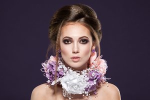 beauty portrait of girl with violet make-up and flowers