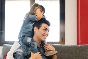 Father piggybacking his daughter.