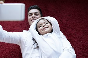 Girl with her father taking selfie.