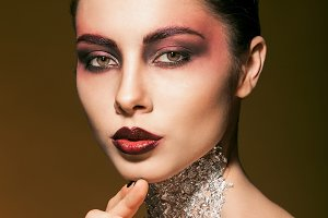 portrait girl with beautiful makeup and silver on the neck, cosmetics