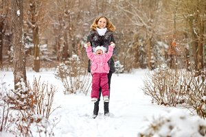 Mother and daughter. Winter fun