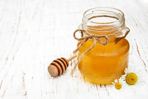 Jar of honey with camomile