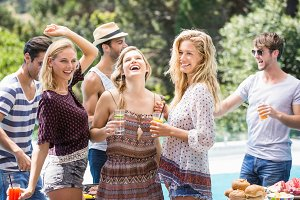 Group of friends enjoying at outdoors barbecue party